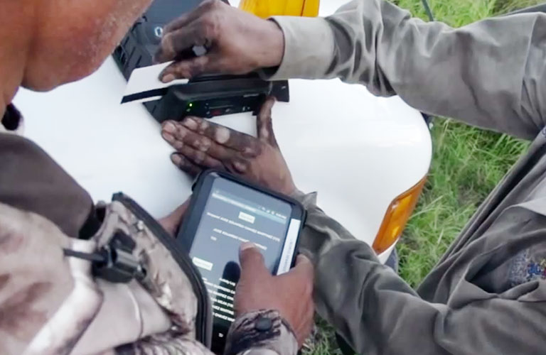 field workers with iPads